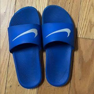 Blue and grey Nike slides